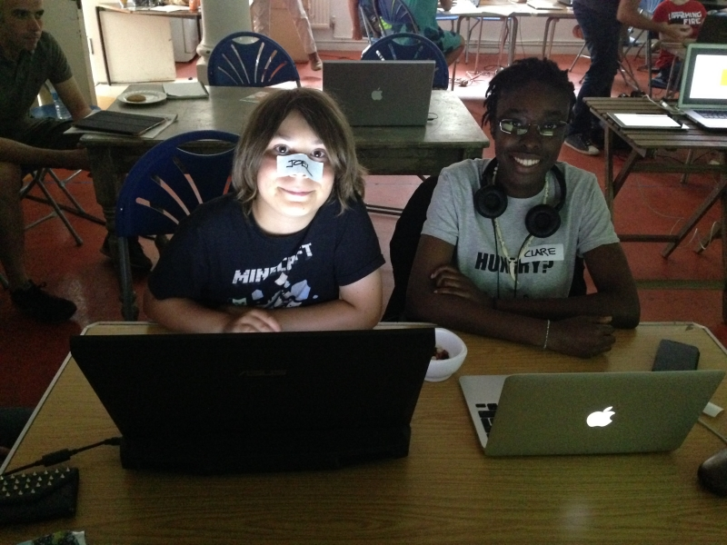 Two young people working on a project together at a Coder Brixton workshop.
